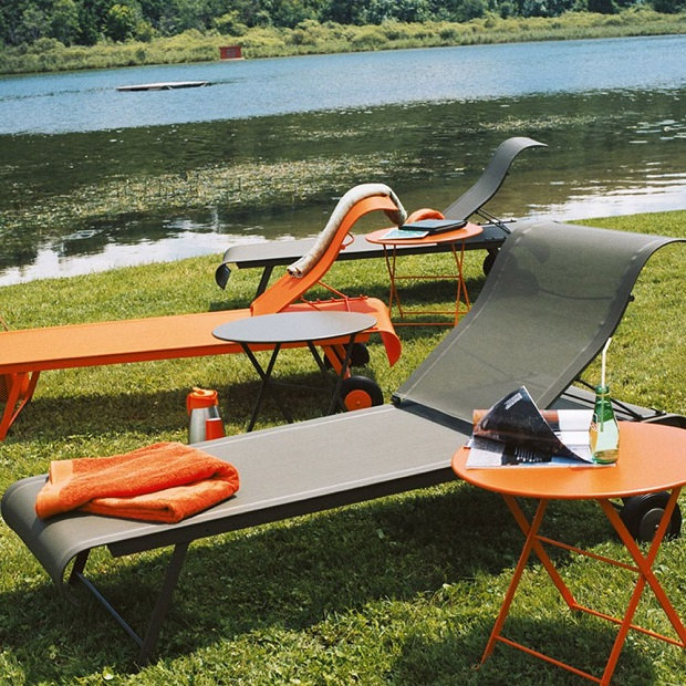 Fermob Dune sunloungers next to a lake