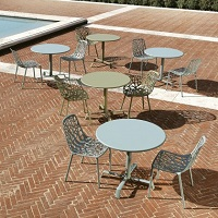 Forest dining chairs and tables by Fast on a patio
