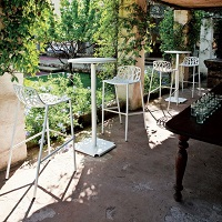 Forest high stools and high tables by Fast in a garden setting