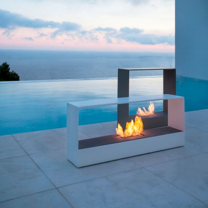 Outside burner next to an infinity swimming pool at sunset