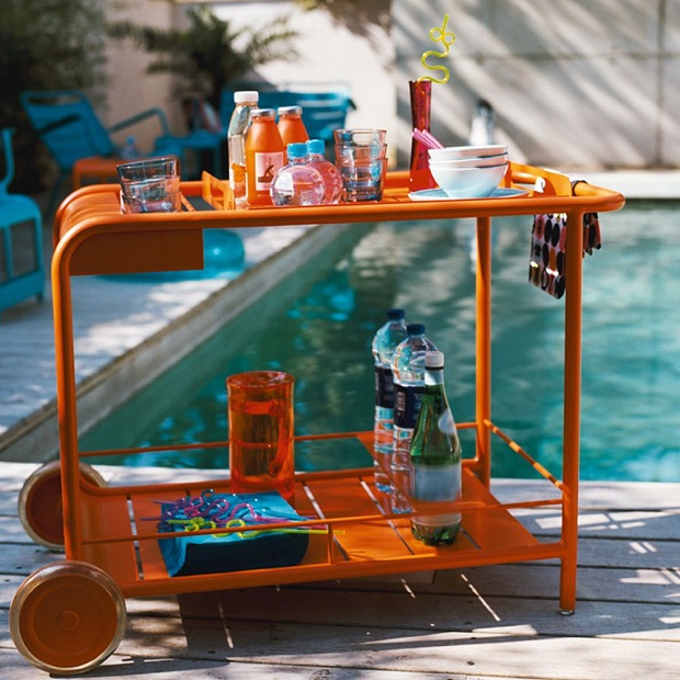 Luxembourg trolley by Fermob next to a swimming pool