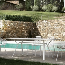 Radice quadra table by Fast next to a swimming pool