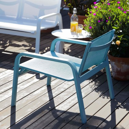 Blue low armchair outside on a decked area