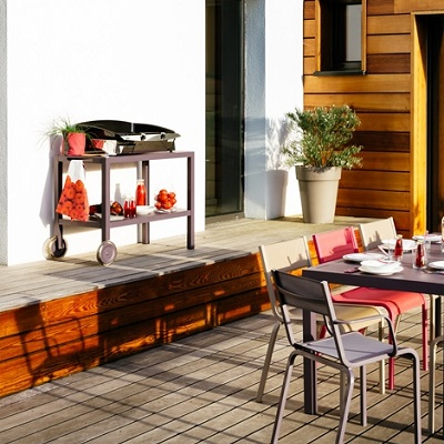 The Quiberon side table with a barbecue in a decked garden patio