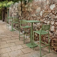 Tonik table tops and chairs by Fast in an outdoor patio area